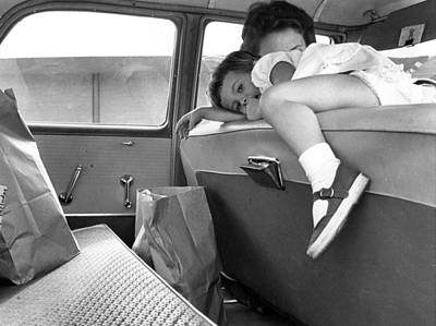 Girl Looks Into Backseat Poster by Retro Images Archive