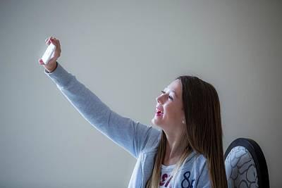 Girl Taking Selfie On Smartphone Poster by Samuel Ashfield