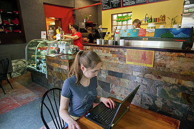 Girl Using A Laptop In A Cafe Poster