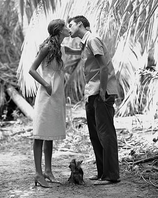 Gisele Bundchen Kissing A Young Man Poster by Arthur Elgort