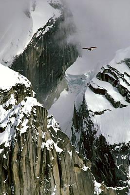 Glacier Pilot & Plane In Ak Range Poster by Jeff Schultz