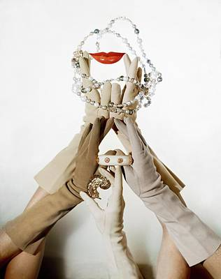 Gloved Hands Holding Jewelry Poster