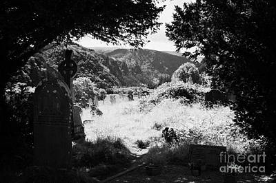 Graves In The Graveyard Looking Out Down To The Valley In Glendalough Part Of The Monastic Site Poster by Joe Fox