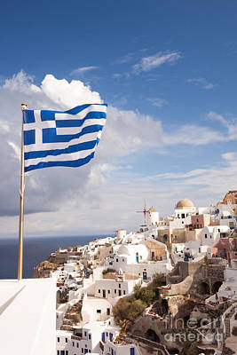 Greek Flag Waving On Oia - Santorini - Greece Poster by Matteo Colombo