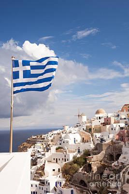 Greek Flag Waving On Oia - Santorini - Greece Poster