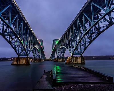 Green Light On The Pier Below Twin Spans On A Misty Dawn Poster