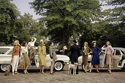 Group Of Models Posing In Front Of Cars Poster