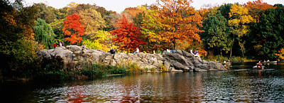 Group Of People Sitting On Rocks Poster by Panoramic Images