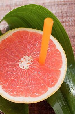 Half A Pink Grapefruit With A Straw Poster