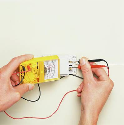 Hand Inserting Black And Red Wires Poster by Dorling Kindersley/uig