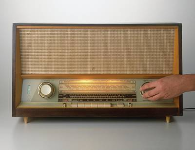 Hand Turning On A Vintage Radio Poster