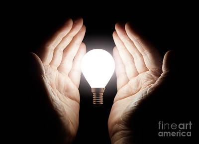 Hands Holding Light Bulb Poster by Simon Bratt Photography LRPS