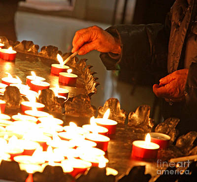 Hands Of An Elderly Woman Lighting A Candle Poster by Federico Candoni