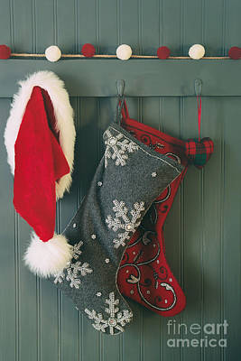 Poster featuring the photograph Hanging Stockings And Santa Hat On Hook by Sandra Cunningham