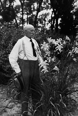 Hans Peter Sass Standing Beside A Flowering Plant Poster by Fleeta Brownell Woodroffe
