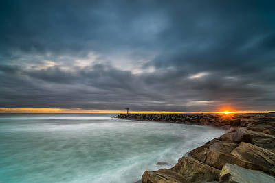 Harbor Jetty Sunset Poster by Larry Marshall
