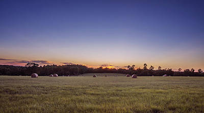 Hay Bales In A Field At Sunset Poster