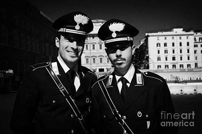 head and shoulders of Two Arma Dei Carabinieri Italian police officers on duty in Piazza Venezia Rom Poster by Joe Fox