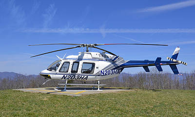 Helicopter On A Mountain Poster by Susan Leggett