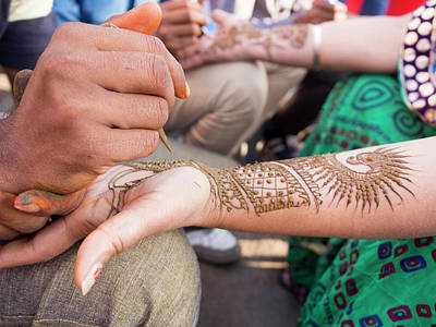 Henna Being Applied On Woman's Hand Poster