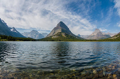 High Clouds Over Swiftcurrent Lake Poster by Greg Nyquist