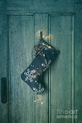 Holiday Stocking With Lights Hanging On Old Door Poster