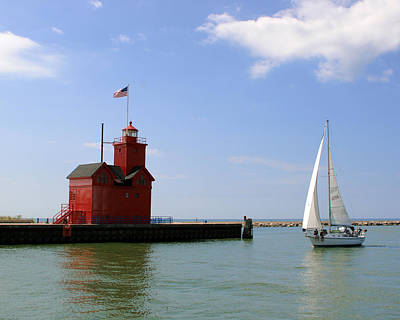 Holland Harbor Lighthouse With Sailboat Poster by George Jones