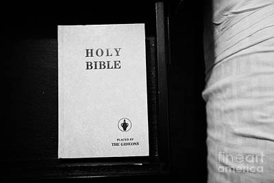 holy bible left by the gideons in a drawer at the side of the bed in a hotel room in Las Vegas Nevad Poster by Joe Fox