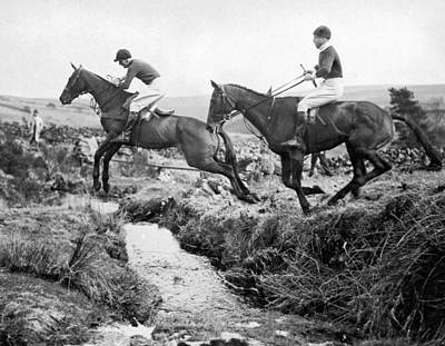 Horses Jumping A Creek Poster by Underwood Archives