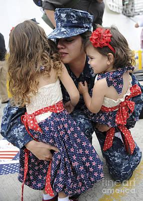 Hospital Corpsman Hugs Her Daughters Poster