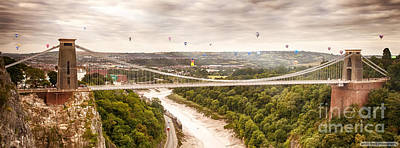 Hot Air Balloons Behind Suspension Bridge Poster