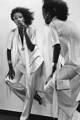 Iman Checking Her Lipstick In A Mirror Poster