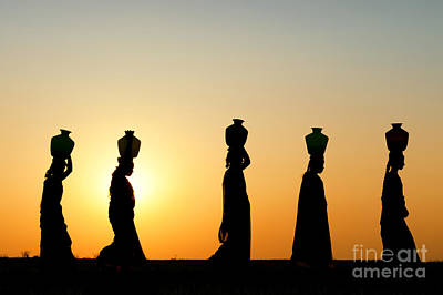 Indian Women Carrying Water Pots At Sunset Poster
