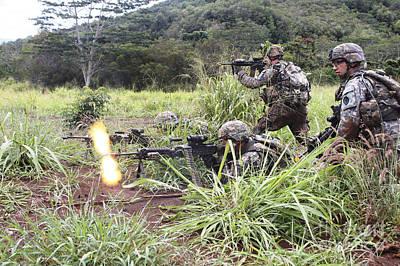 Infantryman Fires A Burst Poster by Stocktrek Images