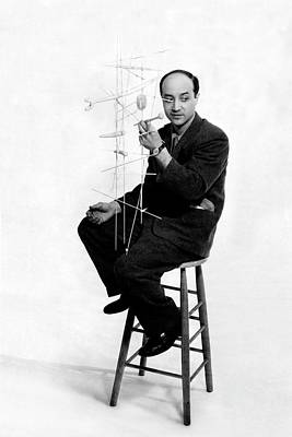 Isamu Noguchi Holding One Of His Structures Poster