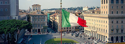 Italian Flag Fluttering With City Poster by Panoramic Images