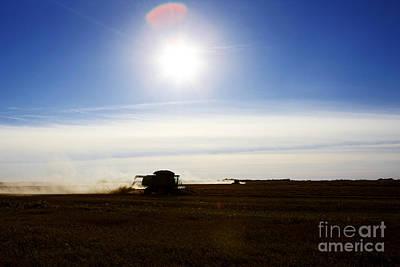 Joe Fox Fine Art - Bringing In The Harvest On The Prairies Of Saskatchewan Poster by Joe Fox