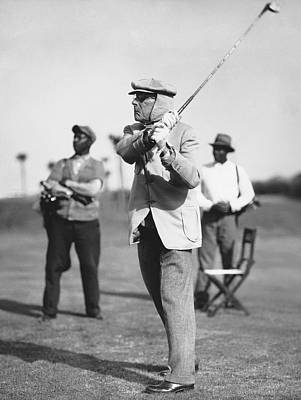 John D. Rockefeller Golfing Poster by Underwood Archives