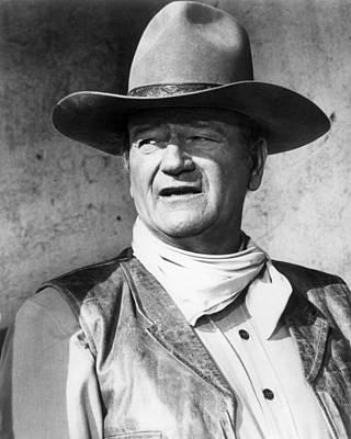 John Wayne In Rio Lobo  Poster by Silver Screen