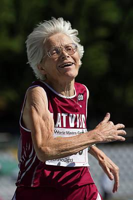 Joyful Senior Female Athlete Poster