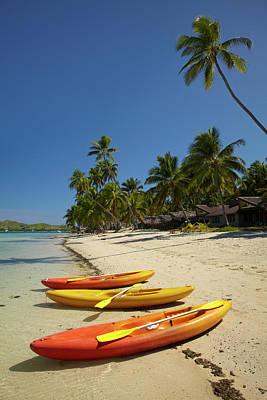 Kayaks On The Beach, Plantation Island Poster by David Wall