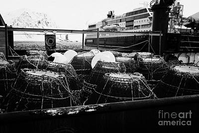 king crab pots on the rear deck of a fishing boat Honningsvag harbour finnmark norway europe Poster
