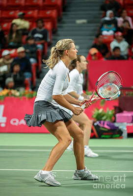 Kirilenko And Hingis In Doha Poster by Paul Cowan