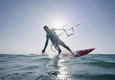 Kitesurfer Illuminated By The Sunlight Poster by Ben Welsh