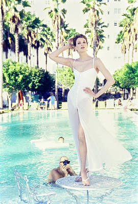 Kristen Mcmenamy Wearing A White Dress By A Pool Poster