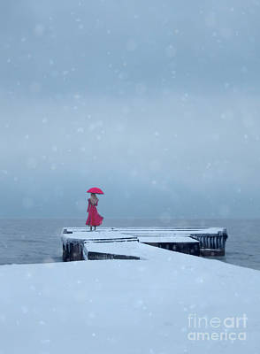 Lady In Red On Snowy Pier Poster