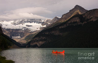 Poster featuring the photograph Lake Louise Canoes by Chris Scroggins