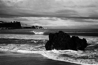Large Rock On Ballycastle Beach In Winter County Antrim Northern Ireland Poster by Joe Fox