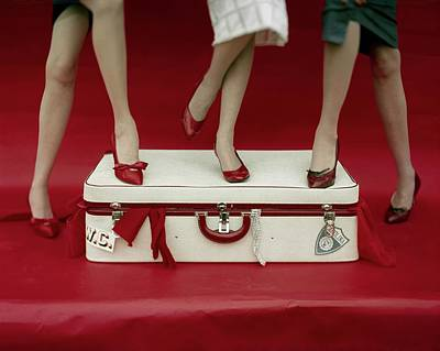 Legs Of Models Standing On A Suitcase Poster