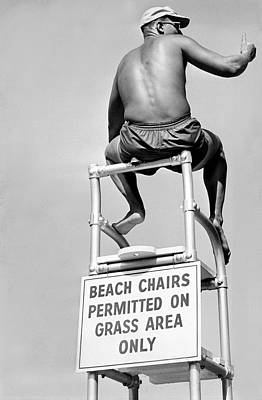 Lifeguard At The Beach Poster by Underwood Archives